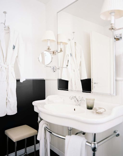 love the half black bathroom walls with white and chrome details