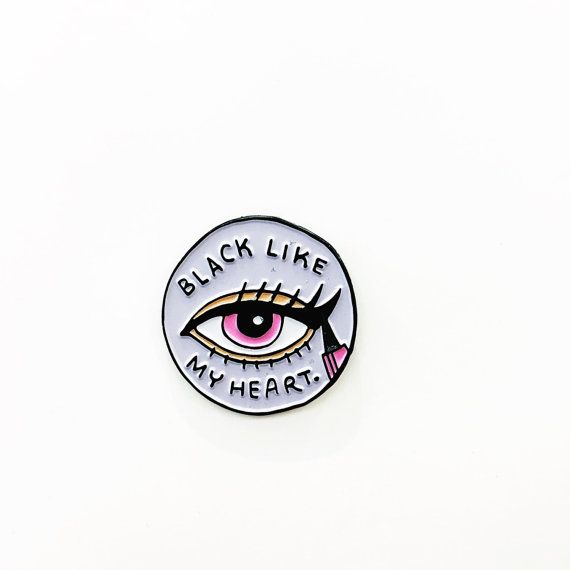 Youre not doing it right if youre eyeliner isnt sharp and black like your heart !  - 1 circle enamel pin - brushed black metal - lavender, pink,