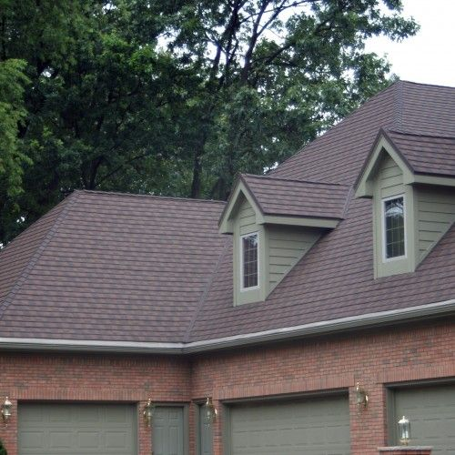 Want a metal roof but don't like the look? Erie Metal Roofs offers dimensional shingles that give your roof a traditional look! Call us today!