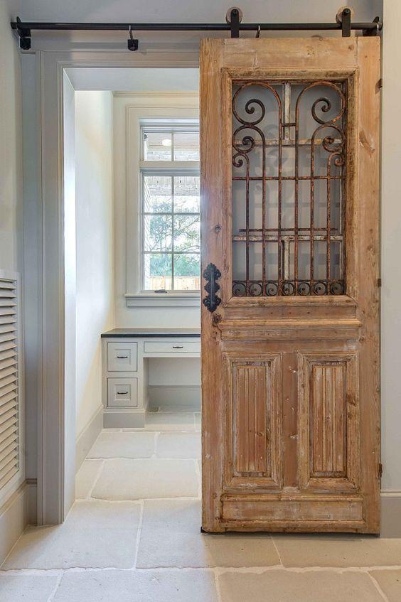 Antique door used as sliding door with barn door hardware