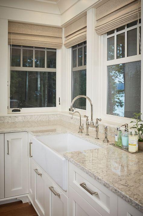 Durable white granite countertop with farmhouse sink.