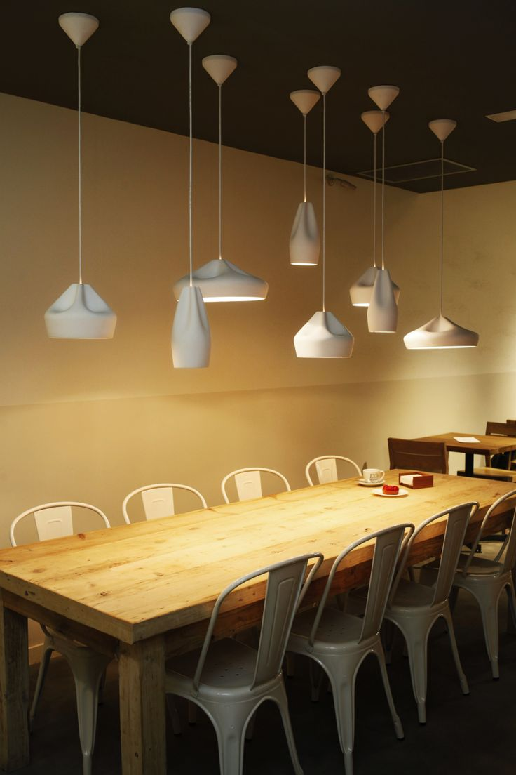 Pleat Box pendant lamps by Xavier Mañosa & Mashallah in L'Obrador bakery, Barcelona. Interior design by Sandra Tarruella