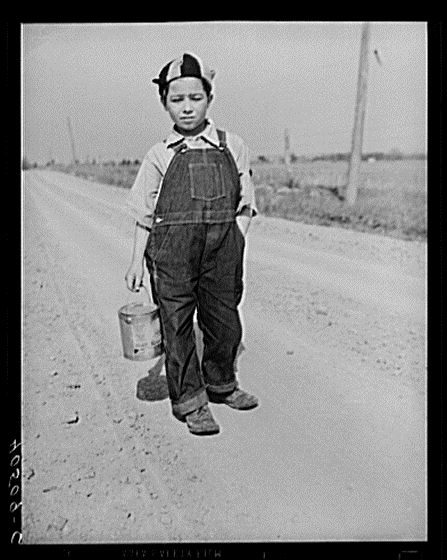Boy on way home from school. Can contains his lunch. Near Sterling, Virginia