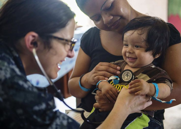 Lt Cmdr. Melissa Buryl, from Canton, Ohio, a pediatrician stationed at Naval Medical Center Portsmouth, Va., checks a child's vital signs at the Hattieville Government School, April 17, 2015 . The school is one of two medical mission sites set up for medical personnel from the Military Sealift Command hospital ship USNS Comfort (T-AH 20) to provide services during Continuing Promise 2015. Continuing Promise is a U.S. Southern Command-sponsored and U.S. Naval Forces Southern Command/U.S. 4th…
