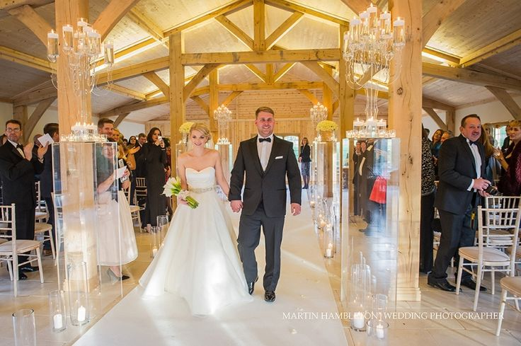 Colshaw-Hall-winter-wedding | Couple walking down the aisle of the Ceremony Hall | Martin Hambleton Cheshire wedding photographer