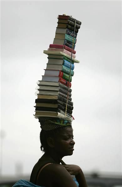 """Jan 28, 2010 – A woman carries books for sale in Luanda, Angola. © Rafael MARCHANTE (Photographer. Lisboa, Portugal) via Reuters. View """"The day in photos"""" slide-show at link to see original image. ... KEEP attribution & links when repinning or posting to other social media (ie blogs, twitter, tumblr etc). Don't pin the art & erase the artist. Give credit where due. See: http://pinterest.com/picturebooklove/how-to-pin-responsibly/  -pfb"""