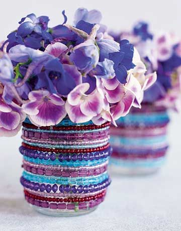 TO DO: Find those old beaded bracelets I don't wear anymore...Sparkling beaded bracelets encircle an old canning jar, add lovely flowers to match color in bracelets