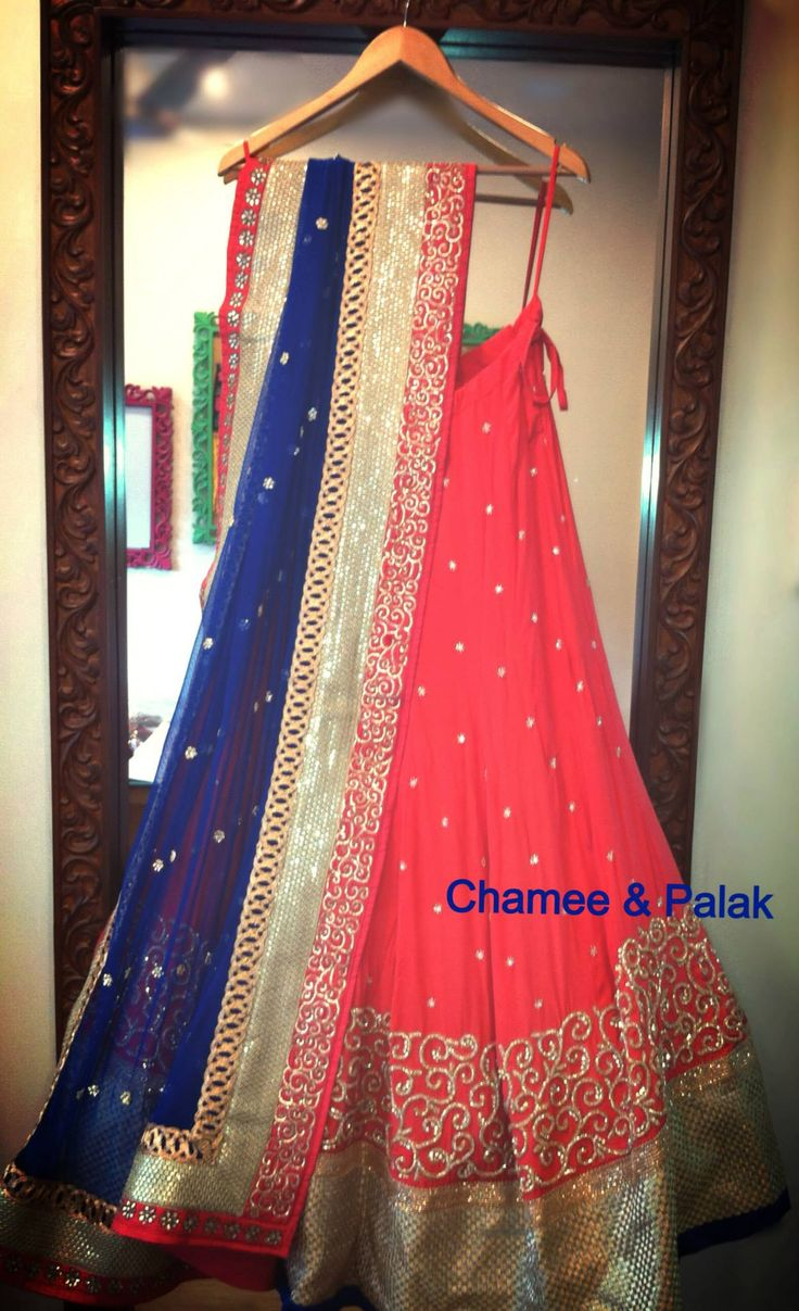 Lehenga by Chamee & Palak. Coral & Blue Swirl Lehenga The joy of re-pinning ur own designs!! :)