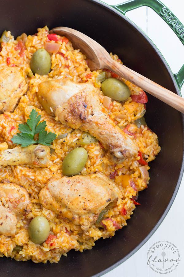 Spanish Chicken and Rice - is made with fresh veggies and spices! Also known as Arroz Con Pollo, this meal is one that the entire family with love!