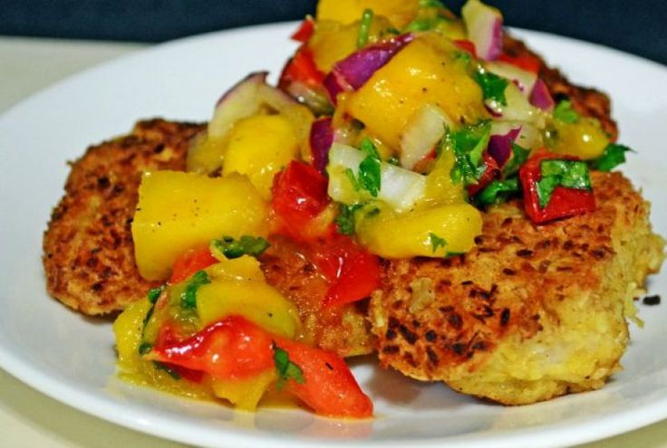 Enjoy the taste of summer with this coconut-crusted rockfish, cooked in a mix of butter and coconut oil, that's topped with a tropical mango salsa.