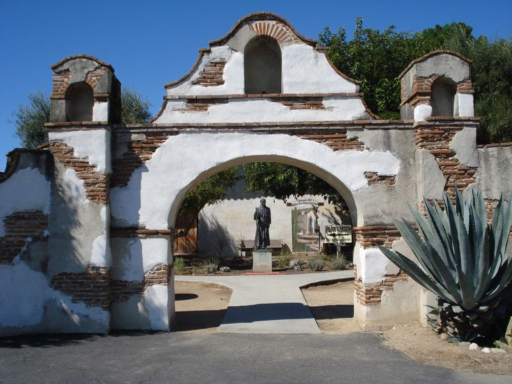 Mission San Miguel, CA the statue is of Fr Serra the founder of the California Missions