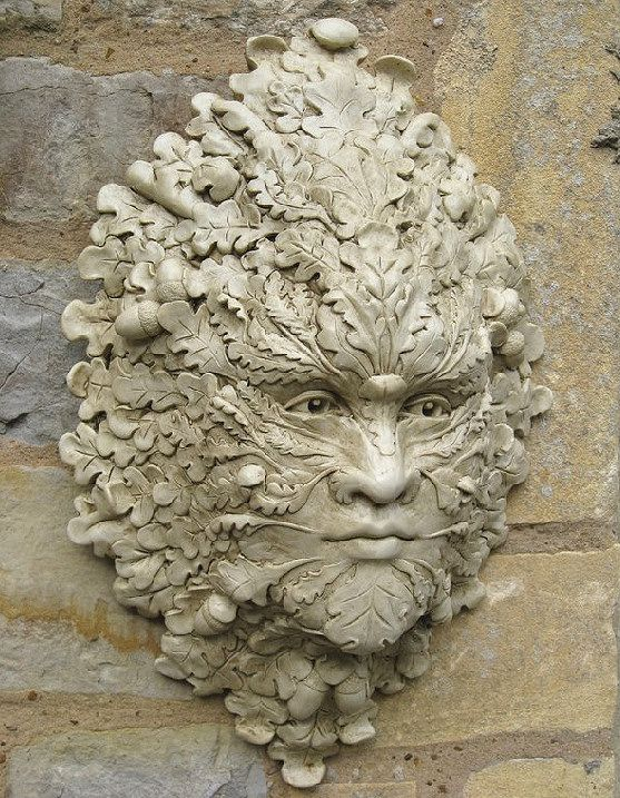 Green man with oak leaves and acorn, for the garden