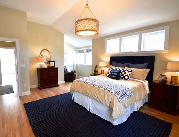 Love the navy blue, sand, and white colors of this bedroom.  The house is near the water, so this color scheme is perfect.