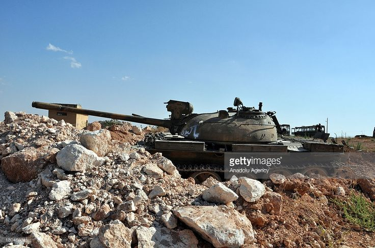 A destroyed tank at 46th regiment captured by Free Syrian Army (FSA) on September 4, 2013 near Aleppo, Syria. FSA members mend and use the tanks and other armoured wehicles turned into scrap heap at the 46th regiment known as Bashar al- Assad's bastion and captured by FSA about a year ago near Aleppo, Syria.