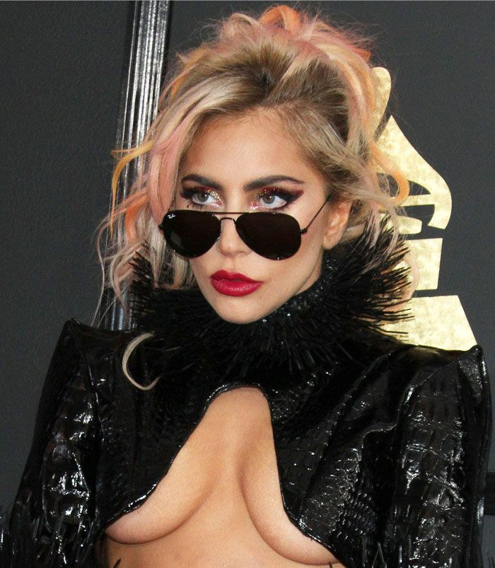 Lady Gaga lets it all hang loose in a cropped embossed jacket