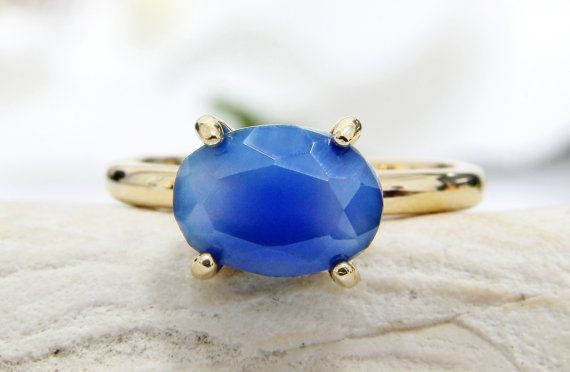 This ring features a beautiful blue Chalcedony gemstone set in a delicate prong setting ring. ☛ Ring size - all sizes available,choose your size before adding the item to your shopping cart. => Gemstone Type - Blue Chalcedony => Gemstone Size - 7x10mm => Gemstone Cut - Oval => Metal