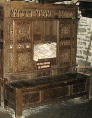 Breton box bed:Brittany is famous for its lit-clos (enclosed bed) tradition. Its box beds often have beautiful, intricate carving on the doors, and are sometimes one above the other in a double-decker, two-storey arrangement. The two pictured both come from Finistère, the north-western tip of France. The right-hand one has a linen chest serving as a step up.