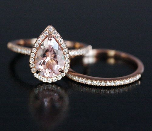 This Stunning delicate and feminine 14k Gold Single Halo Ring Features a flawless Natural Morganite Pear measuring 10x7mm and surrounded with