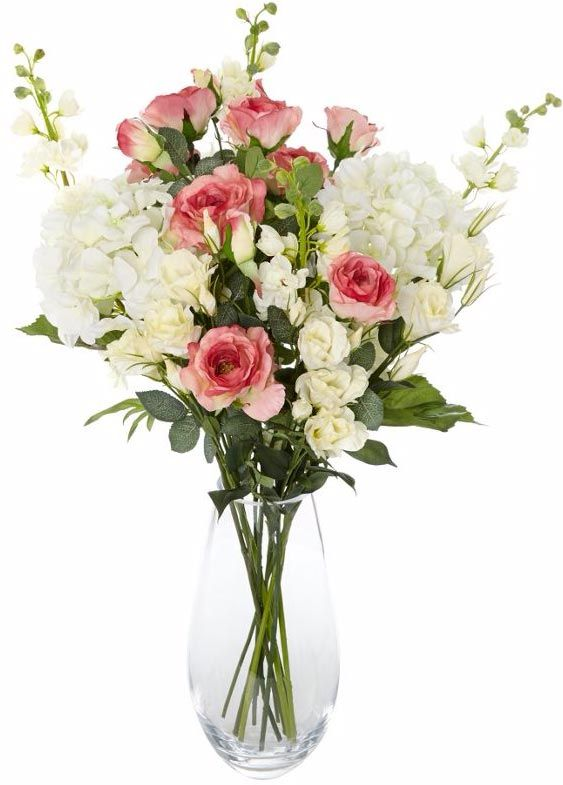 White artificial flower arrangement with hydrangeas and delphiniums