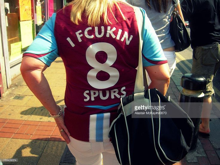 CONTENT] A fan of West Ham United football club displays the traditional rivalry with Tottenham Hotspur (Spurs) on her replica shirt. Picture taken on Green Street, near West Ham's Boleyn Ground (Upton Park).
