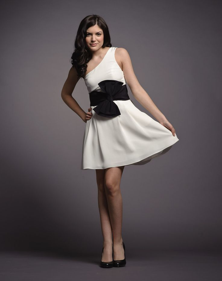 What to wear: Bride - This feminine yet modern dress by one of our very own Canadian designers, Jay Godfrey, is light and flirty. This black and white silk dress is chic yet has the casual element of pockets on its full skirt. Match it perfectly with black heels or try an unexpected pop of colour. Shop this look here: https://rentfrockrepeat.com/products/white-one-shoulder-silk-dress-with-black-bow