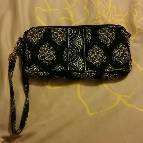 Navy Vera Bradley wristlet Navy, blue, and white Vera Bradley wristlet. Most wear and tear on handle strap. Machine washable and will look good as new. Make me an offer! Vera Bradley Bags Clutches & Wristlets