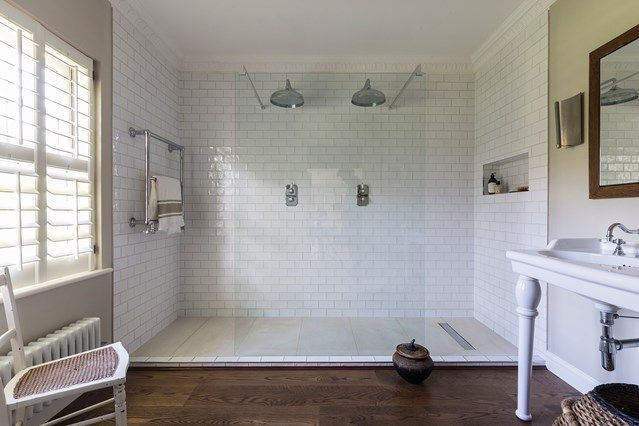 White Subway Tile Shower - Stylish floor tiles, mosaic walls, colourful alcoves and everything in-between - interior design ideas on HOUSE by House & Garden