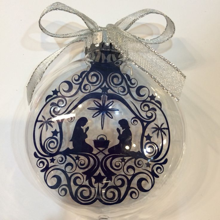 """Adhesive vinyl (651) cut with Cameo Silhouette die cutting machine and adhered to clear acetate sheet cut to fit inside ornament.  Design from Silhouette Store (called """"Nativity Ornament).  Clear ornament purchased from Michael's."""