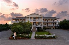 This elegant coastal Inn is located on one of the most beautiful islands in North Carolina. Beautifully appointed rooms with king sized beds, private baths, private screened porches, rocking chairs, love seats, wet bars, and private storage rooms