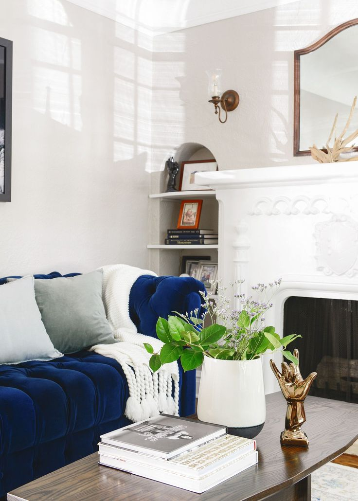 Navy velvet tufted sofa and warm grey walls is a sure bet to win my heart. Room sources and more via Yellow Brick Home -- Psst: Using All Modern accessories to finish a room = easy peasy, done and done. Shipping is free over $49, and quick, too! #mymodern