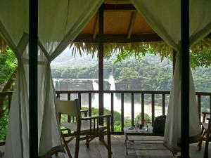 Where to Stay High Up in the Jungle in a Tree House in India: Rainforest Resort, Athirapally Falls, Kerala