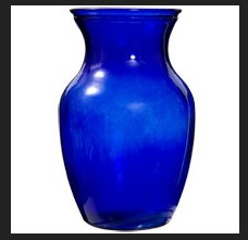Kitchen Decor  -  Cobalt Blue Vase creates blue accents to the simple white interior
