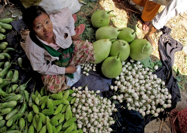 A woman sells fresh farm produce at Thiri Mingalar market, Yangon