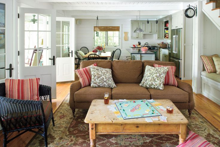 You don't have to give up style even in your high-traffic living room. Guests and kids need not reach for coasters before putting drinks down on the distressed coffee table. Scrapes and dings only add to the character of the piece. A patterned area rug is forgiving of spills and dusty feet.  See this Lakeside Cabin Makeover
