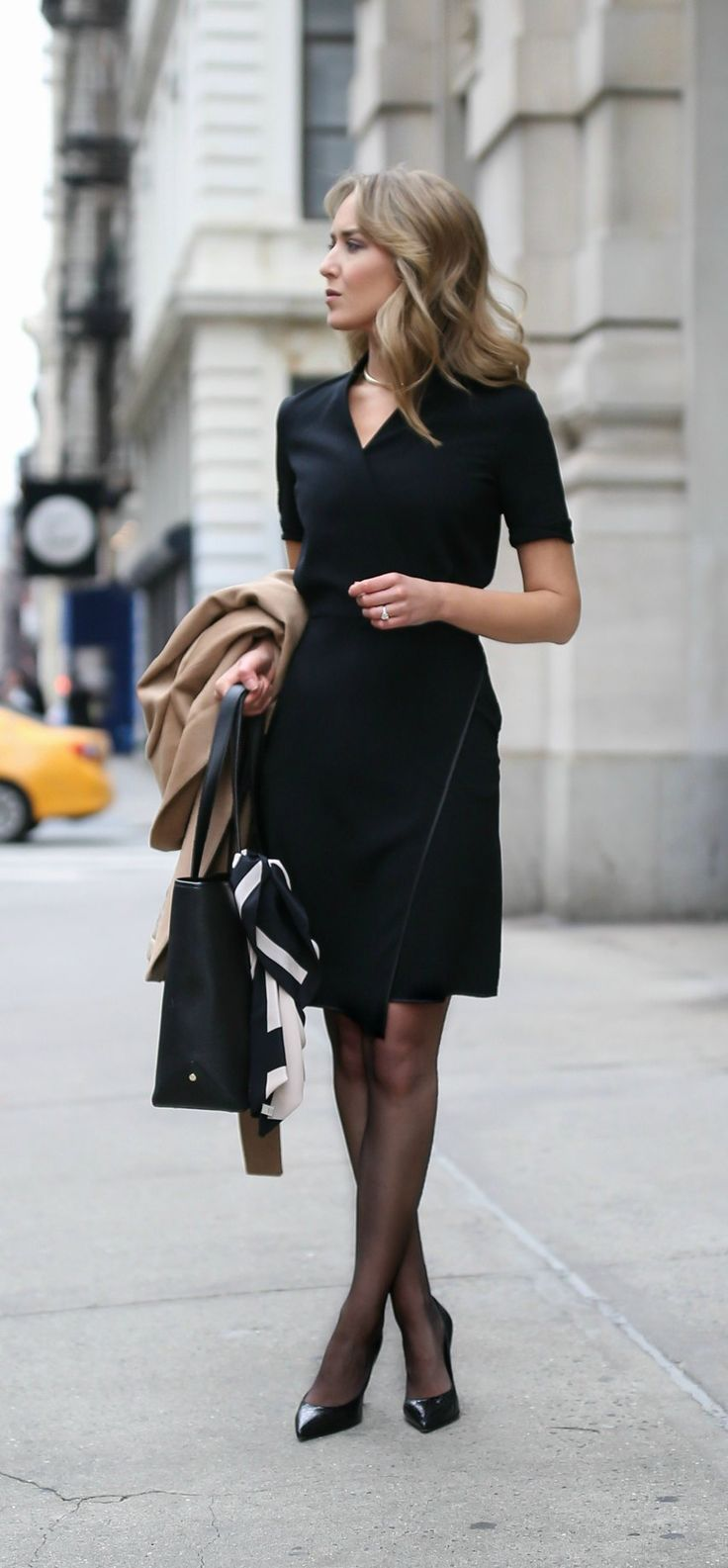 camel tie waist classic wool coat, black faux wrap front v-neck short sleeve sheath dress, sheer black tights, timeless black pointed toe pumps, gold choker necklace, work tote bag  |  @mmlafleur