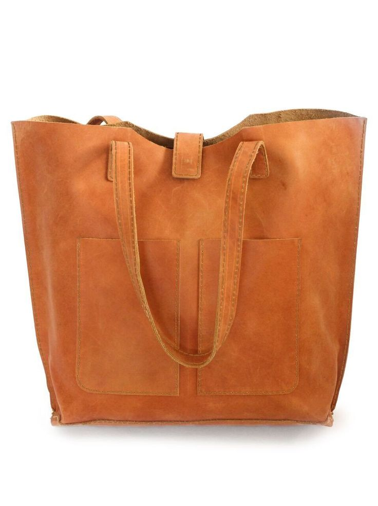 """Ebise Leather Tote is handcrafted in Ethiopia with 100% genuine distressed leather. - Leather Tote measures 12'' H x 16 1/4'' W x 4 1/2'' D - Comfortable, durable straps (straps have a 11"""" drop) - It"""