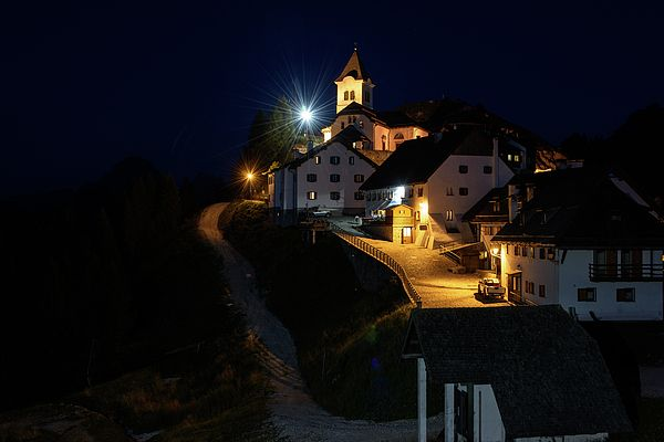 Night View Of The Village Of Monte Lussari At Dusk. Enchantment.
