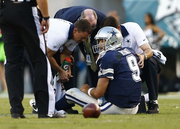 Tony Romo Photos Photos - Quarterback Tony Romo #9 of the Dallas Cowboys is looked at by medical personal after being injured on a sack against the Philadelphia Eagles during the third quarter of a football game at Lincoln Financial Field on September 20, 2015 in Philadelphia, Pennsylvania. - Dallas Cowboys v Philadelphia Eagles