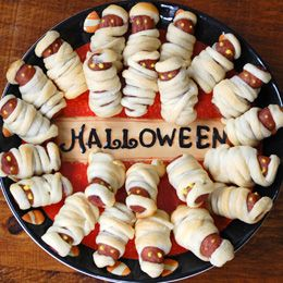"So cute for a halloween party - ""mummies in a blanket"" all-time fave."