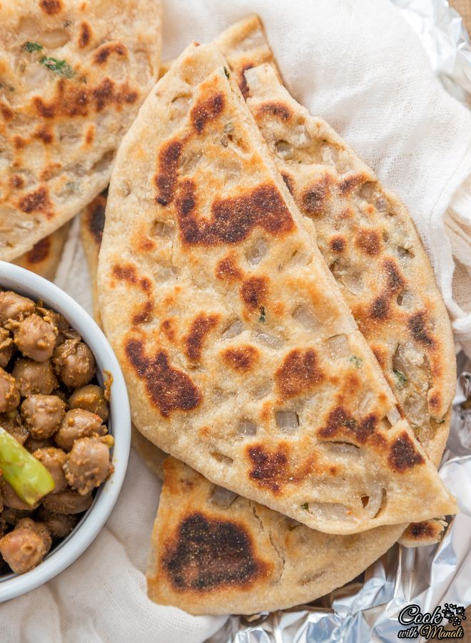 Onion Kulcha is whole wheat leavened Indian bread stuffed with onions. #indian Find the recipe on www.cookwithmanali.com