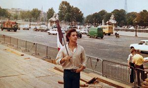 A young Nicolas Sarkozy holds the tricolour flag