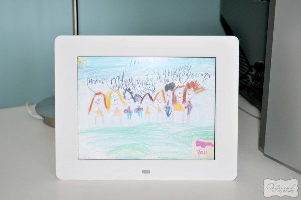 Scan kids artwork and save them to an SD card, then display using a digital photo frame