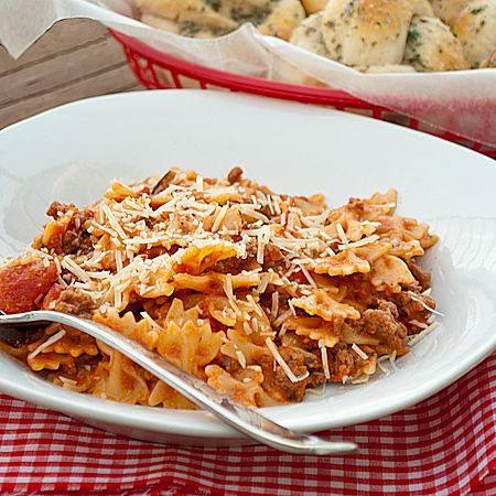 Bow Tie Skillet Lasgna  5.0 from 2 reviews  Print  1 lb. ground beef  1 lb. box or pkg of mini farfalle or mini bow tie pasta  24 oz jar or spaghetti sauce  1 Tbsp olive oil  1 tsp salt  1/2 tsp garlic powder  1 tsp Italian seasoning  1/2 cup shredded mozzarella cheese  1/2 cup sour cream  Parmesan cheese, if desired  In a skillet, brown the ground beef until fully cooked; drain.  Meanwhile, cook the pasta according to package directions. I use the mini because they cook in about 7 minutes…