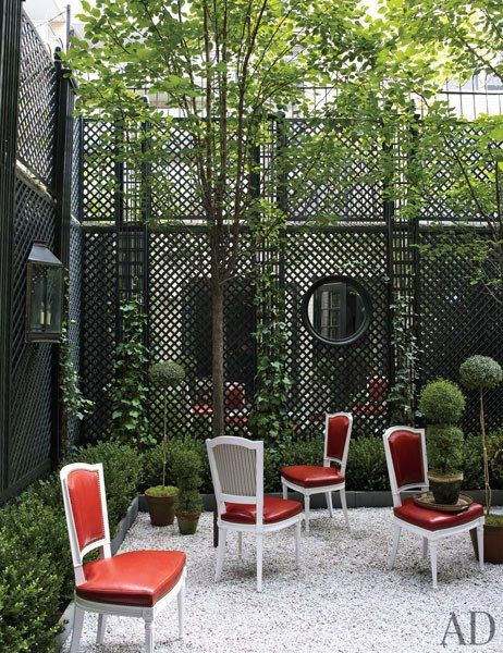 Outdoor garden. Mirrored-back trelliswork + louis chairs | Jeffrey Billhuber, Architctural Digest
