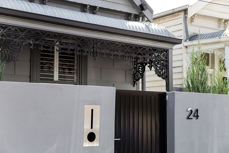 Black gloss front door. Heritage exterior. Dulux charcoal exterior.  Full home renovation in Richmond, Melbourne by the M.J.Harris Group including full interior and exterior painting by M.J.Harris Group. Photo credit J.Harri