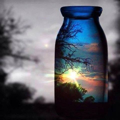Looking at this photo I sit and think how Great it would be if we could capture sunsets like this in a bottle. Put them on the bookshelf, end tables, windowsills etc... Each one unique in its own way. Truly Magnificent Mother Nature is.