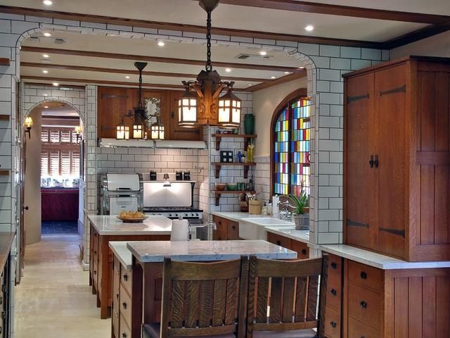 Arts  Crafts Spanish Revival Bungalow Oak custom kitchen cabinets with black hinges and pulls white stone counter subway tiles dark grout 784 best Historic Kitchens images on Pinterest Queen anne 1930s