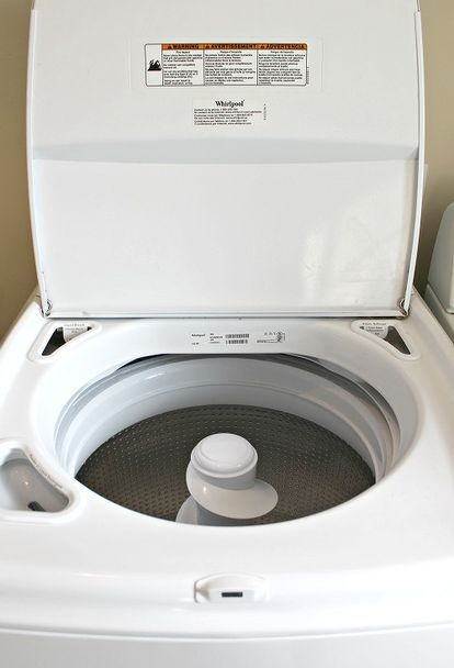 cleaning a top loading washing machine