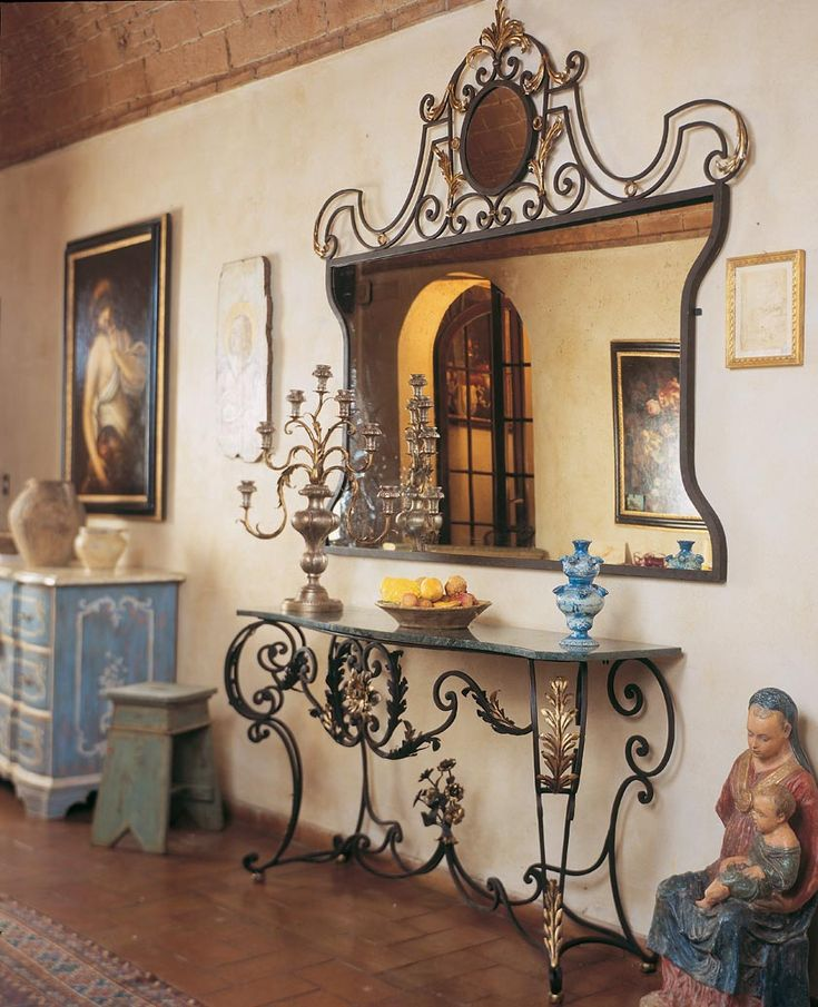 Wrought iron handmade console table and iron ornate mirror. By effebiweb.com