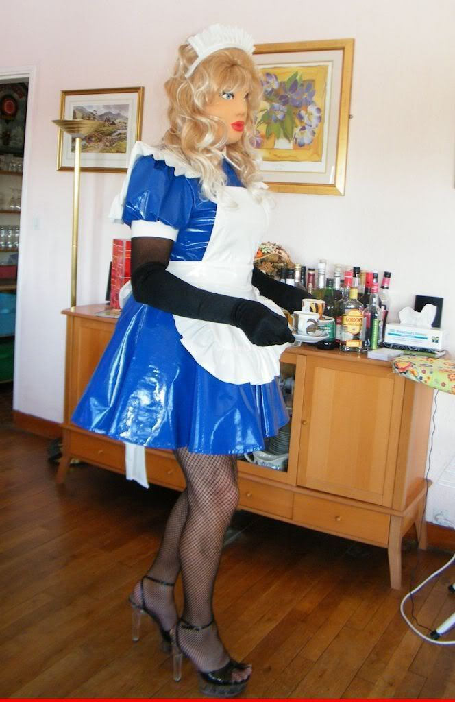 French maid serving coffee to Mistress = click on photo for full size.
